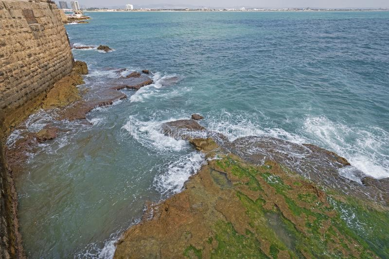 Crashing Waves along coastal walls of a Fortress. In Acre, Israel stock image
