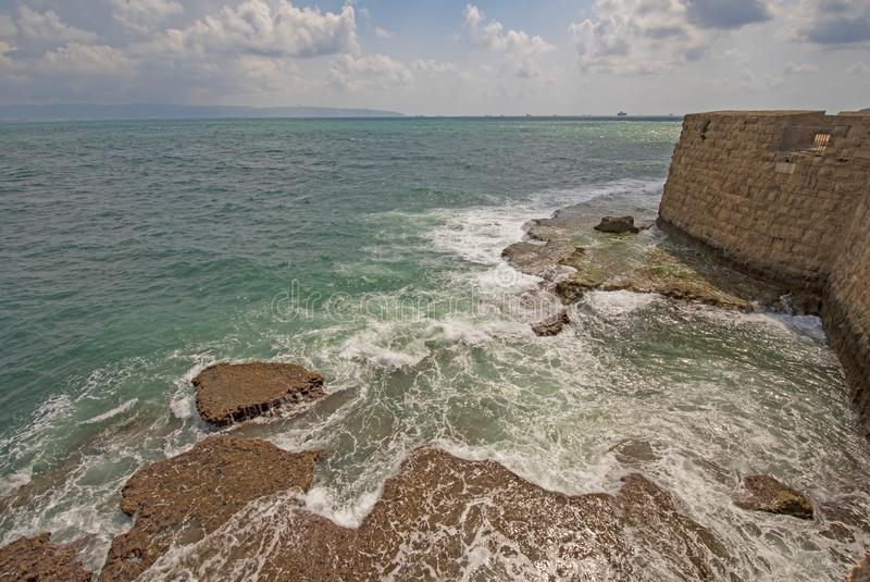 Crashing Waves on a Coastal Fortress. In Acre, Israel stock photography
