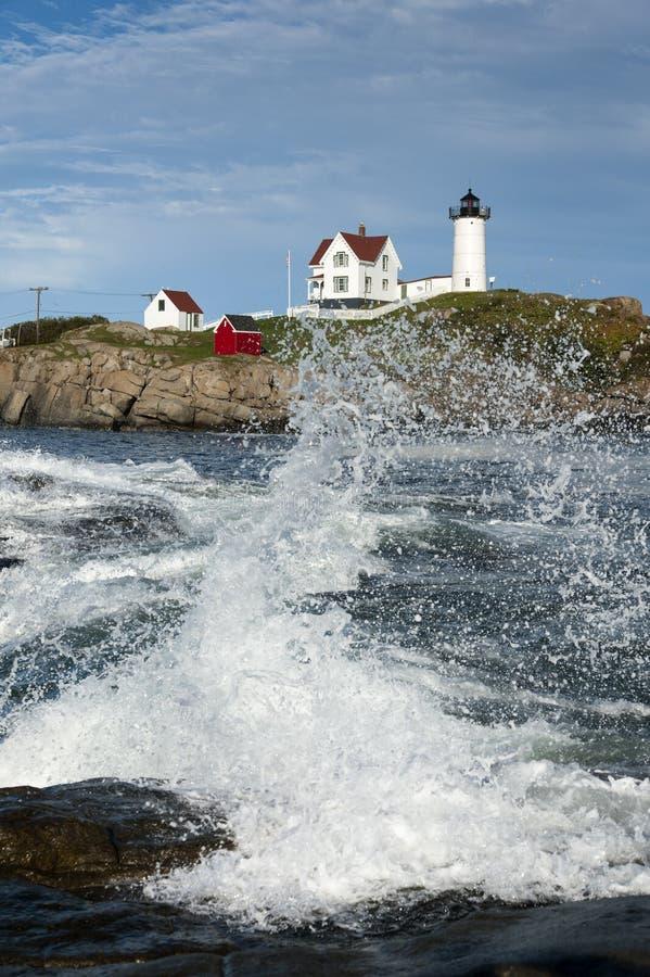 Crashing Waves at Maine's Cape Neddick Lighthouse stock images