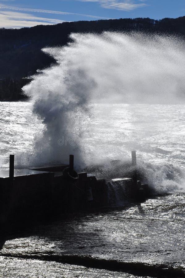 Crashing waves on a pier, lago Maggiore stock photo