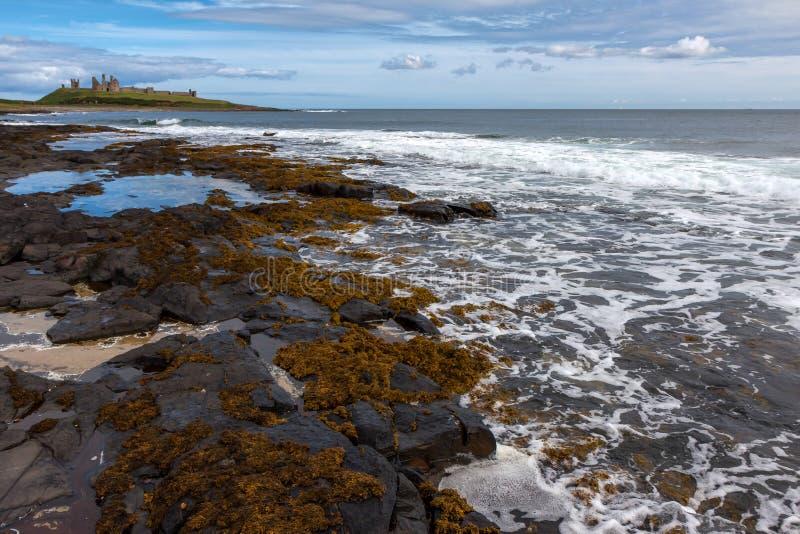CRASTER, NORTHUMBERLAND/UK - 18-ОЕ АВГУСТА: Взгляд Dunstanburgh Ca стоковое изображение