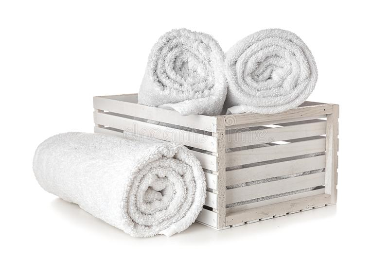 Crate with clean rolled towels on white background royalty free stock image