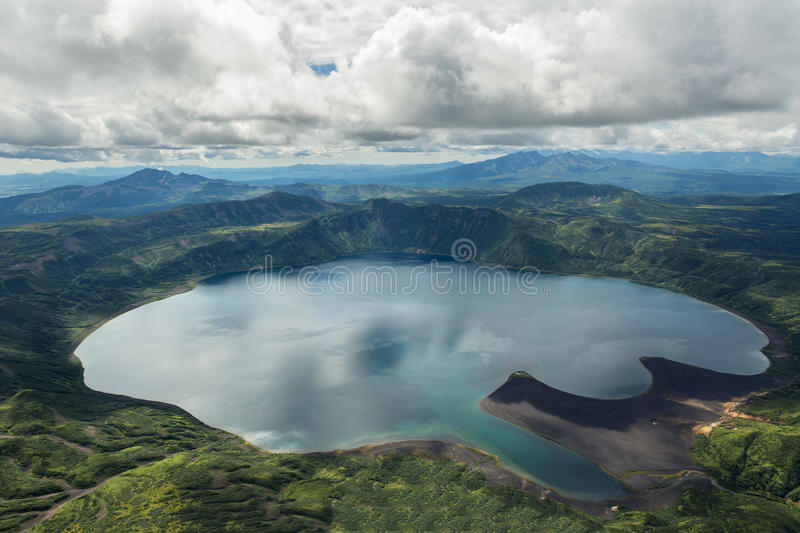 Crater Karymsky Lake. Kronotsky Nature Reserve on Kamchatka Peninsula. View from helicopter stock photos