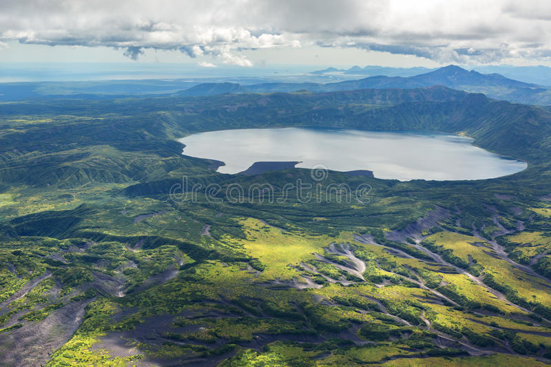 Crater Karymsky Lake. Kronotsky Nature Reserve on Kamchatka Peninsula. View from helicopter stock photo