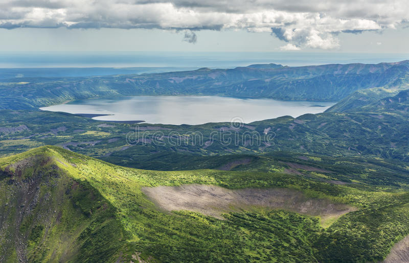 Crater Karymsky Lake. Kronotsky Nature Reserve on Kamchatka Peninsula. View from helicopter royalty free stock photos