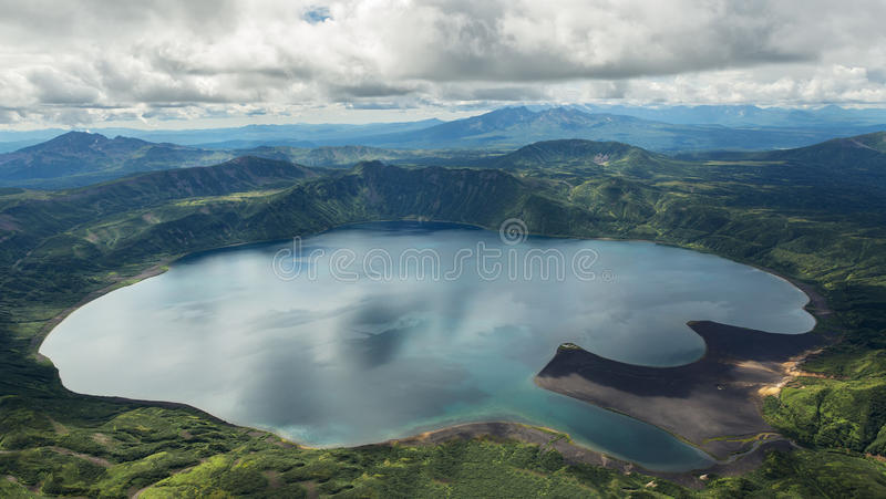 Crater Karymsky Lake. Kronotsky Nature Reserve on Kamchatka Peninsula. View from helicopter royalty free stock image