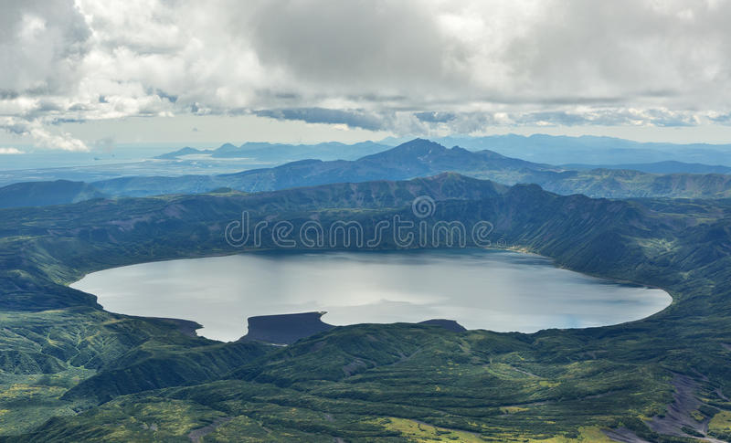 Crater Karymsky Lake. Kronotsky Nature Reserve on Kamchatka Peninsula. View from helicopter royalty free stock photo