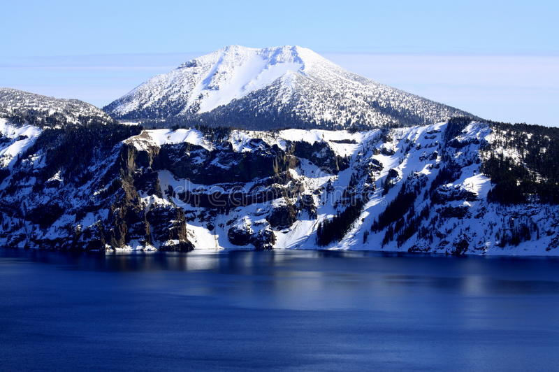Crater Lake and Mount Scott. Snow-capped Mount Scott overlooking Crater Lake stock image