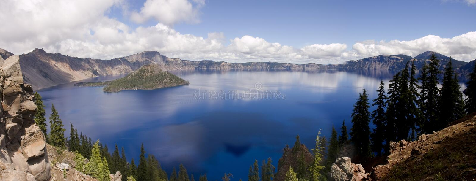 Crater Lake, Oregon. Panorama of the entire lake including Wizard island, at Crater Lake in Southern Oregon. Crater Lake is a caldera left behing when Mount stock photography
