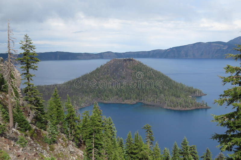 Crater Lake, Oregon, USA. This is Crater Lake in Oregon, United States. It is the deepest lake in the US and the water is said to be one of the bluest in the stock photo