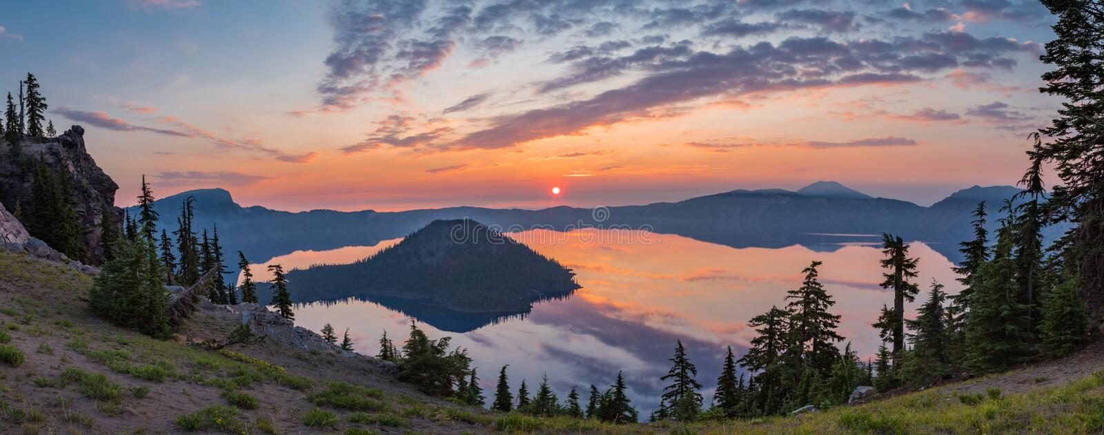 Crater Lake. Panoramic Composition Of Sunrise Over Crater Lake From Rim Trail, Crater Lake National Park, Oregon stock photo
