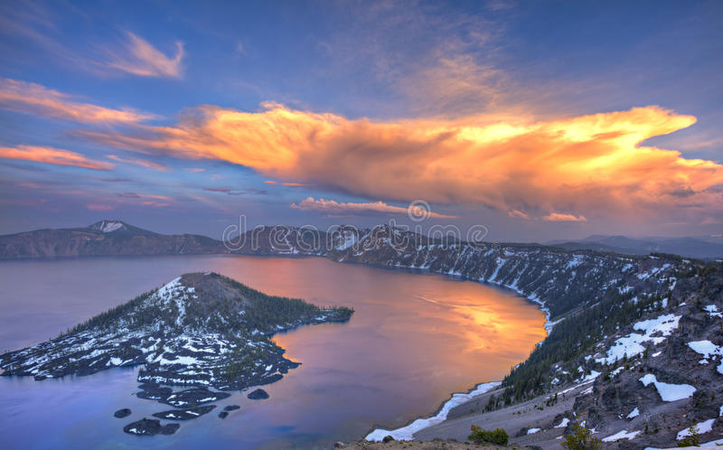 Crater Lake. Sunset at Crater Lake, with red clouds reflection in lake royalty free stock photography