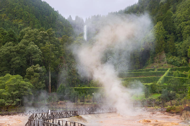 Crater Volcanic mud pools in Azores surrounded by green forest hot spring steam. Crater Volcanic mud pools in Azores surrounded by green forest hot spring with stock photos