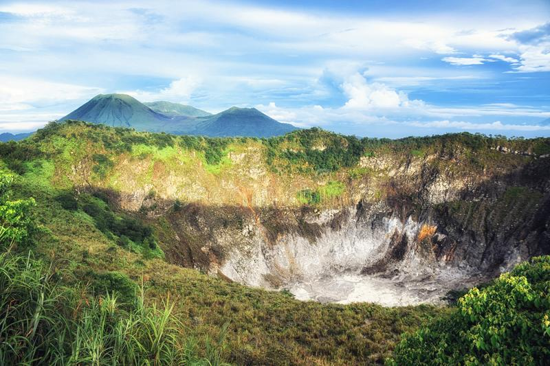 Crater of Volcano Mahawu near Tomohon. North Sulawesi. Indonesia. Tomohon, North Sulawesi, Indonesia - October 03, Beautiful colours as the sun sets over Manado royalty free stock photo
