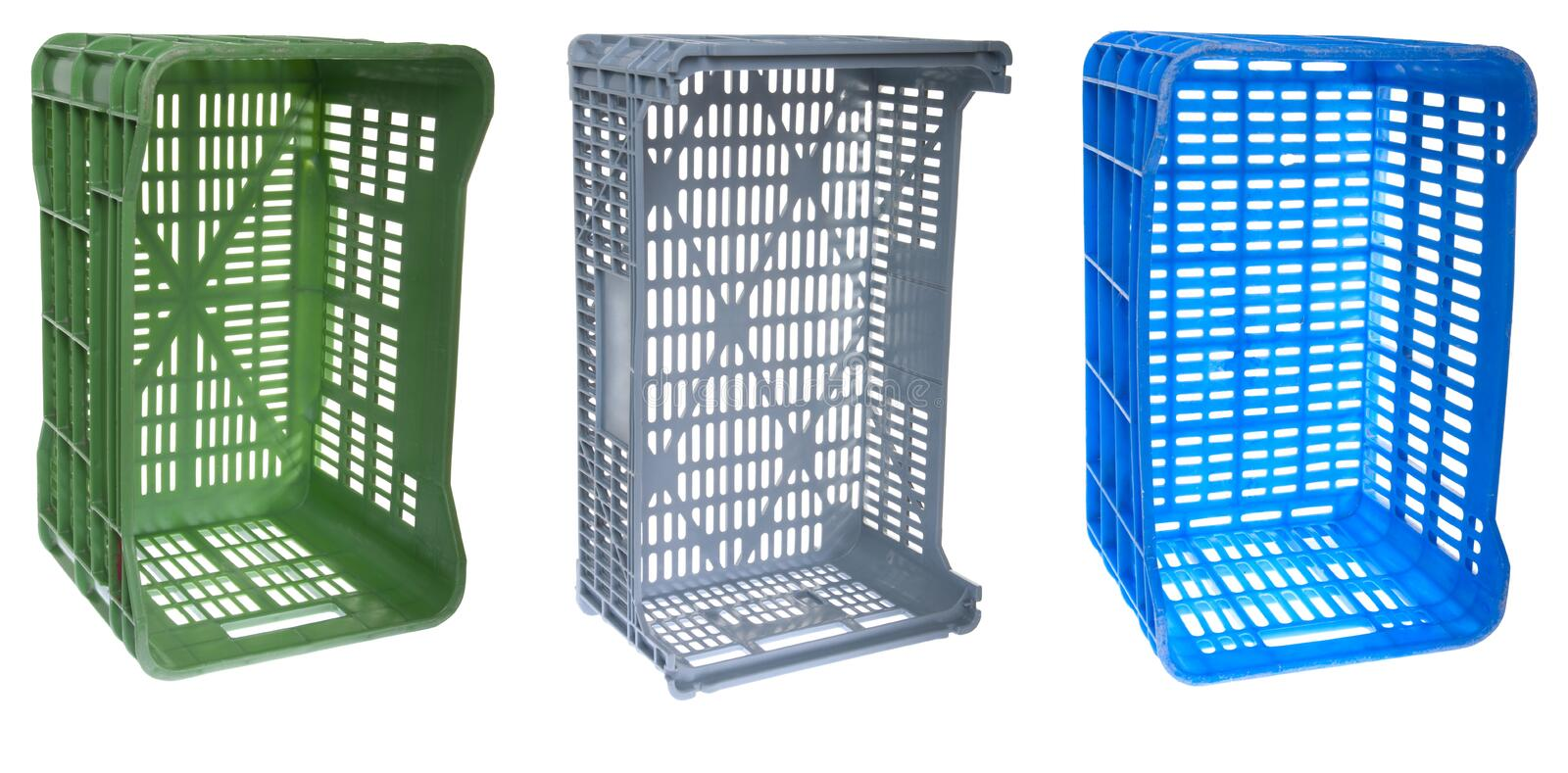 Crates. Colorful fruits and vegetable plastic crates isolated on white background royalty free stock photo