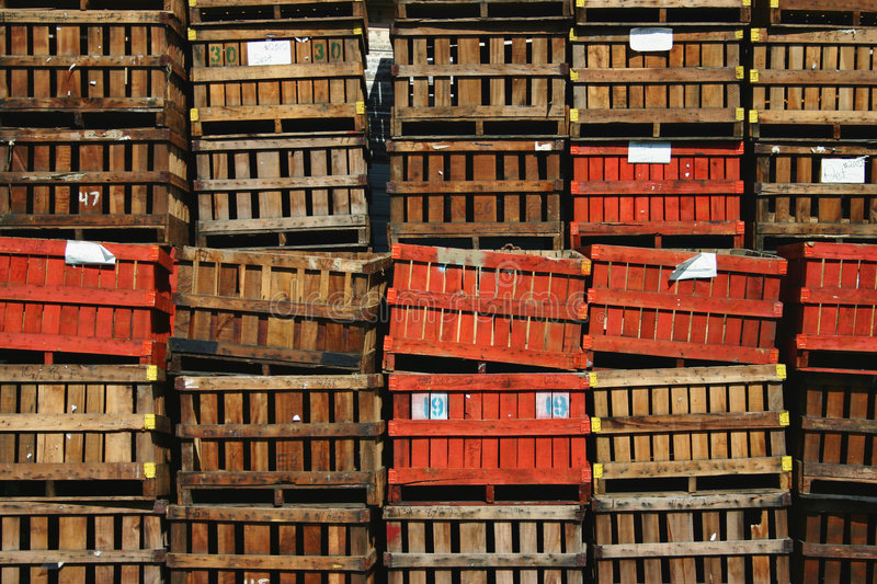 Crates. Stacks of wooden crates or pallets in varying shades of brown to orange royalty free stock photography