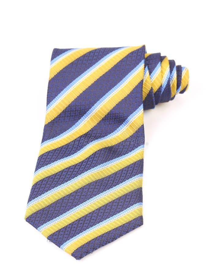 Cravate bleue et jaune roled image stock