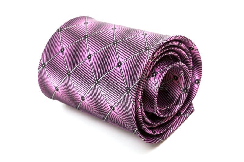 Cravate pourpre pliée images stock