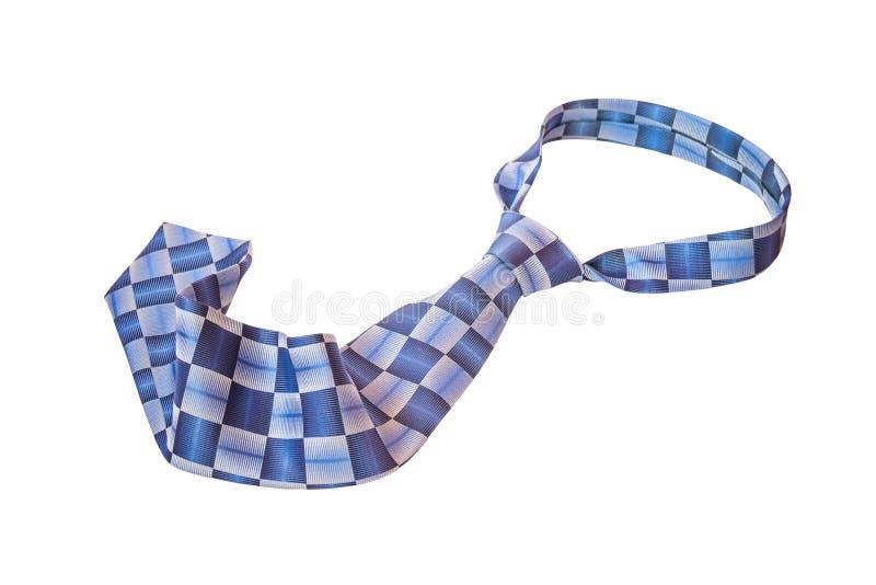 Cravatta blu isolata su bianco Fuoco selettivo immagini stock