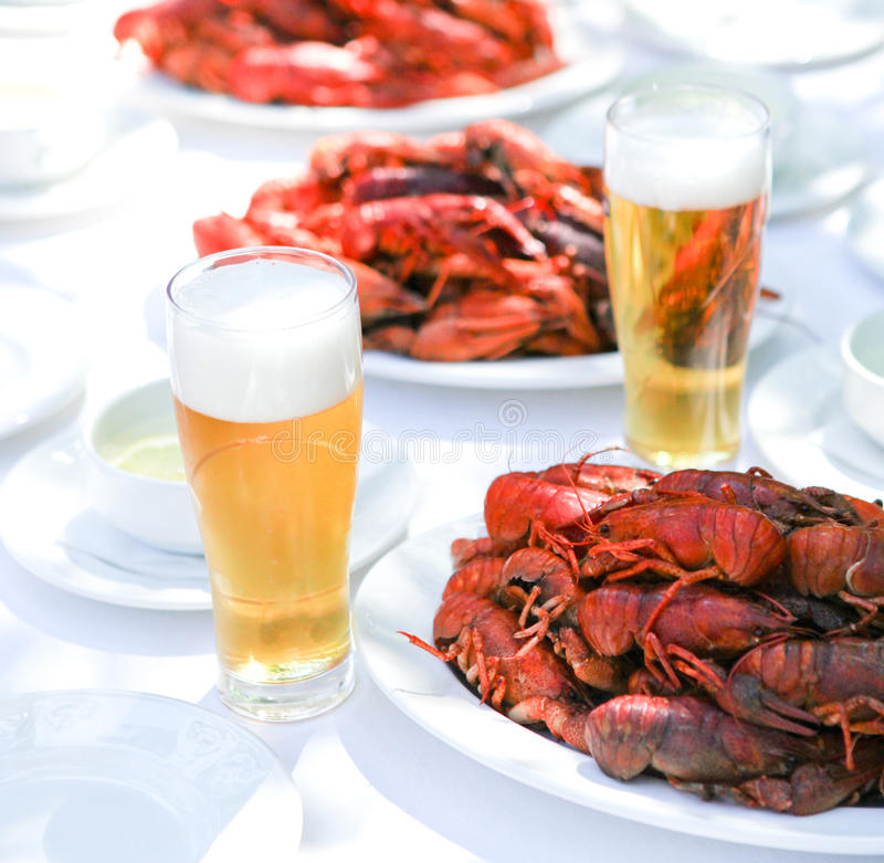Crawfish and beer. Crawfish with fresh cold beer at the table stock photography