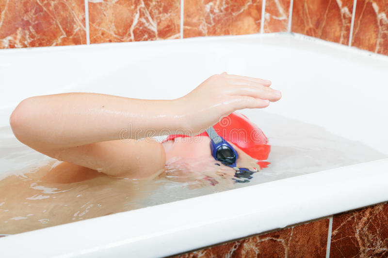 Crawl Swimming In Bath Stock Photo