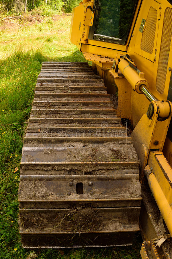 Crawler (continuous tracked tractor) bulldozer track detail. Bulldozer Track and Cab in Summer royalty free stock images