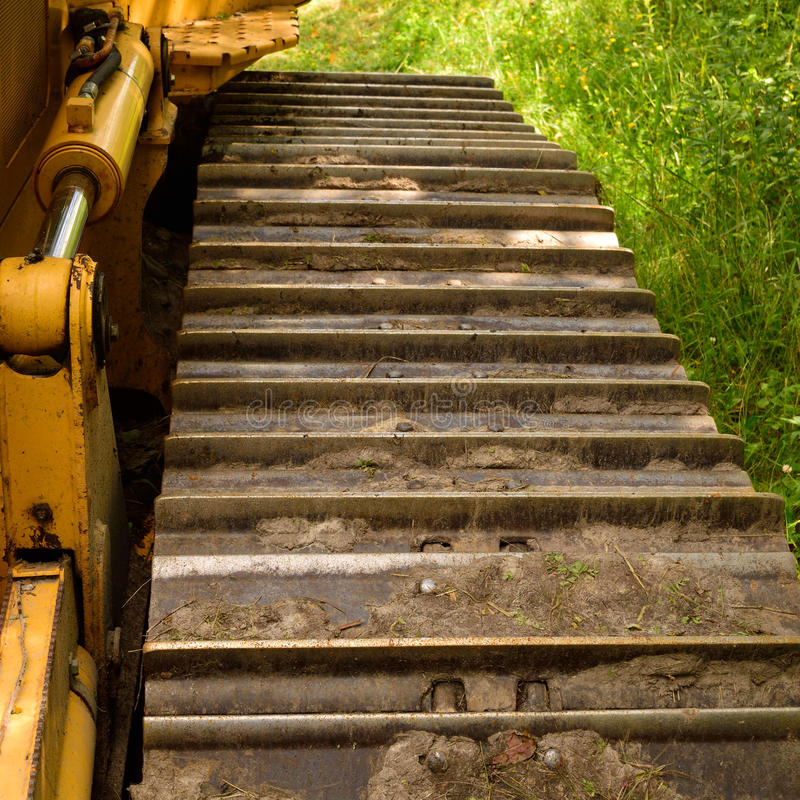 Crawler (continuous tracked tractor) bulldozer track detail. Closeup of Dozer Track Pads stock photography