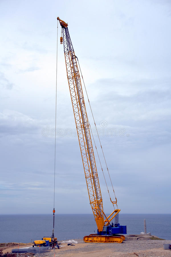 Crawler Derrick Crane on Construction Work Site stock photo