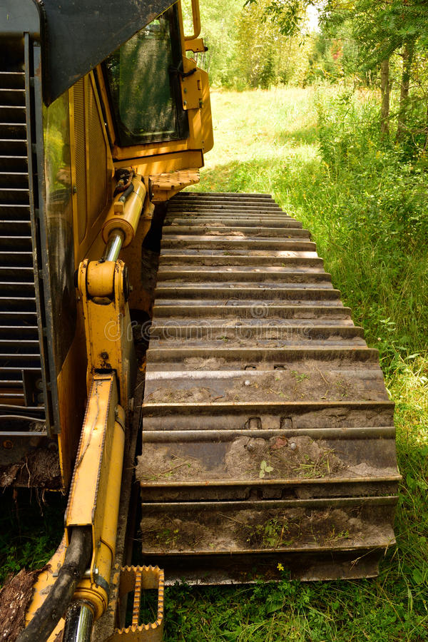 Crawler Dozer Track Pad and Cab Detail. Crawler (continuous tracked tractor) bulldozer track detail stock images