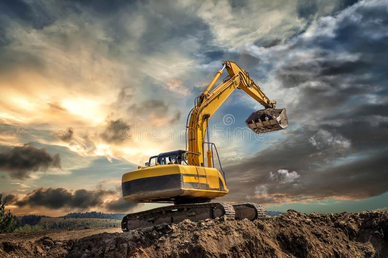 Crawler excavator during earthmoving works stock photos