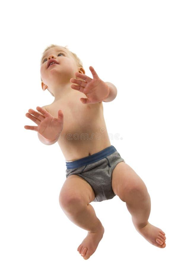 Crawling baby boy stock photos
