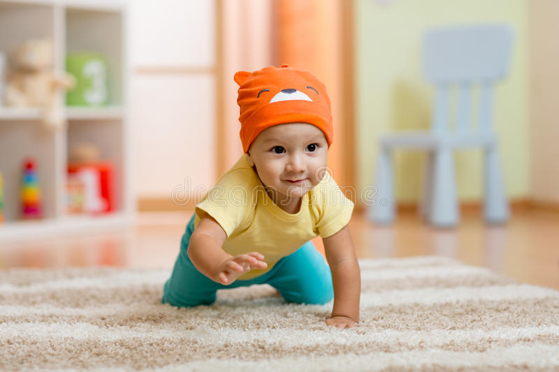 Crawling baby boy at home on floor royalty free stock photos