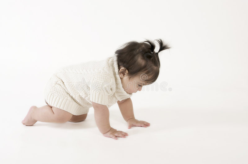 Crawling baby girl stock images