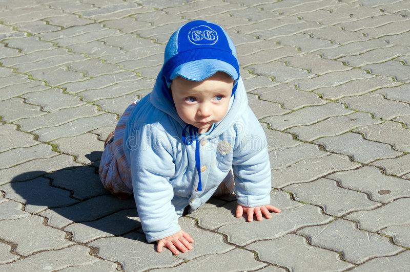 Download Crawling Baby On Paving Stone Stock Image - Image: 4590283