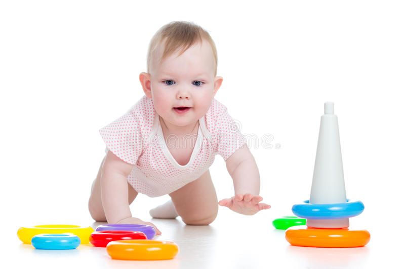 Crawling baby playing with toy stock photography