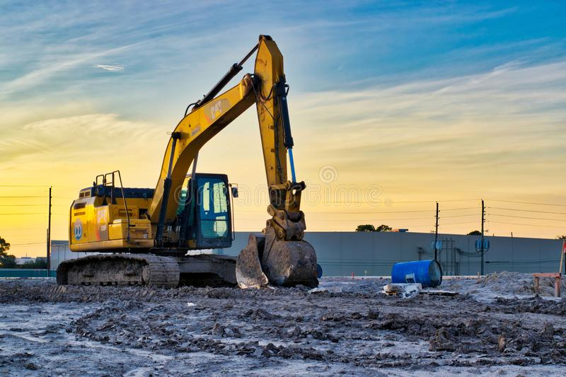 Crawling Excavator digger on construction site at sunset. royalty free stock images