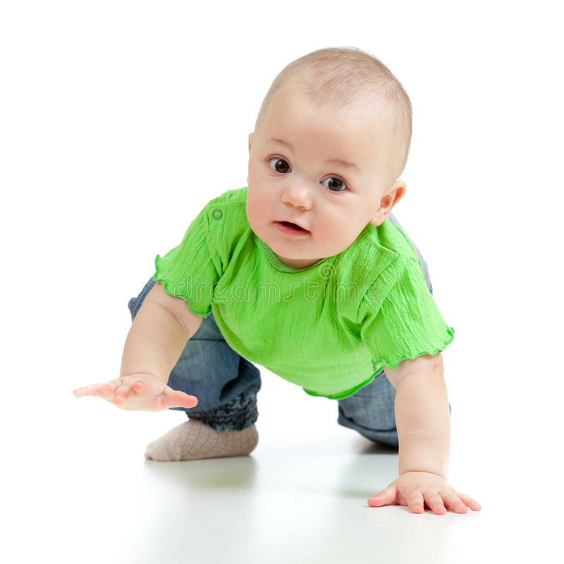 Crawling funny baby goes down on all fours. Cute baby goes down on all fours royalty free stock photography