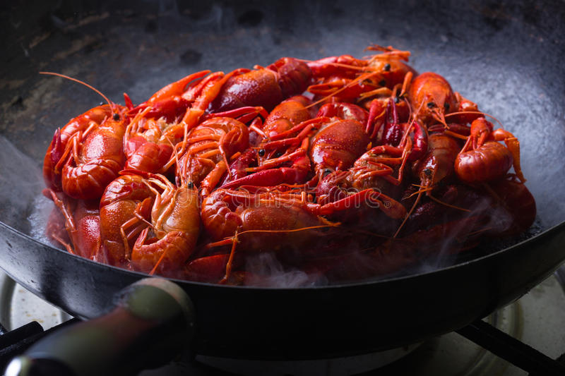 Crayfish. Crayfish are being cooked on a frying pan stock photography