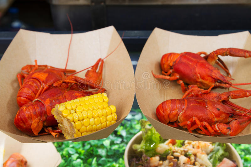 Crayfish or crawfish being served on food stall on open kitchen international food festival event of street food.  royalty free stock images