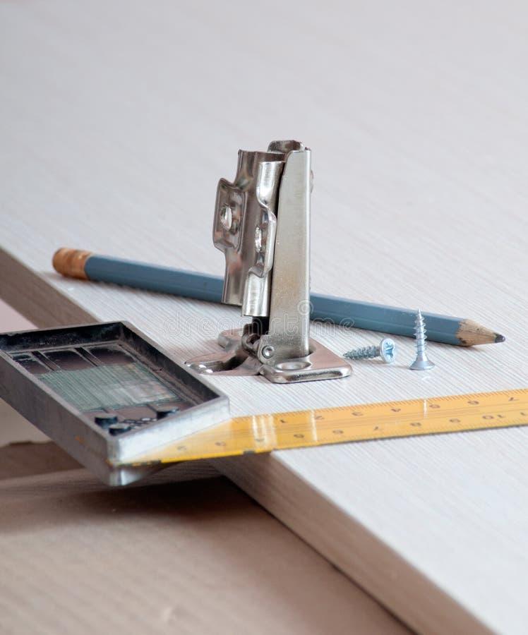 Crayon, boucle de meubles, règle-coude image libre de droits