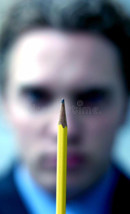 Crayon de fixation d'homme d'affaires photographie stock libre de droits