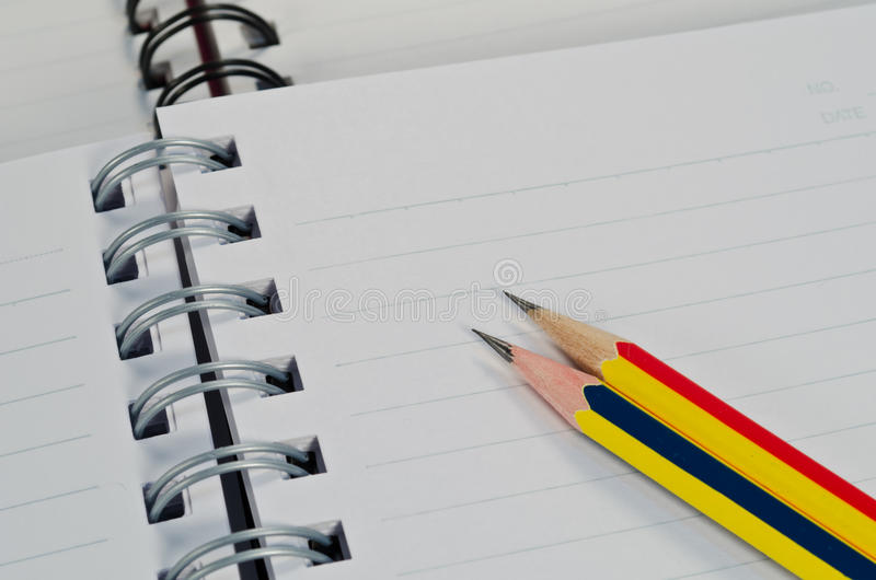 Crayon et cahier photo stock