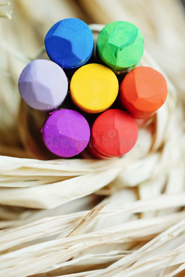 Crayon flower on raffia royalty free stock image
