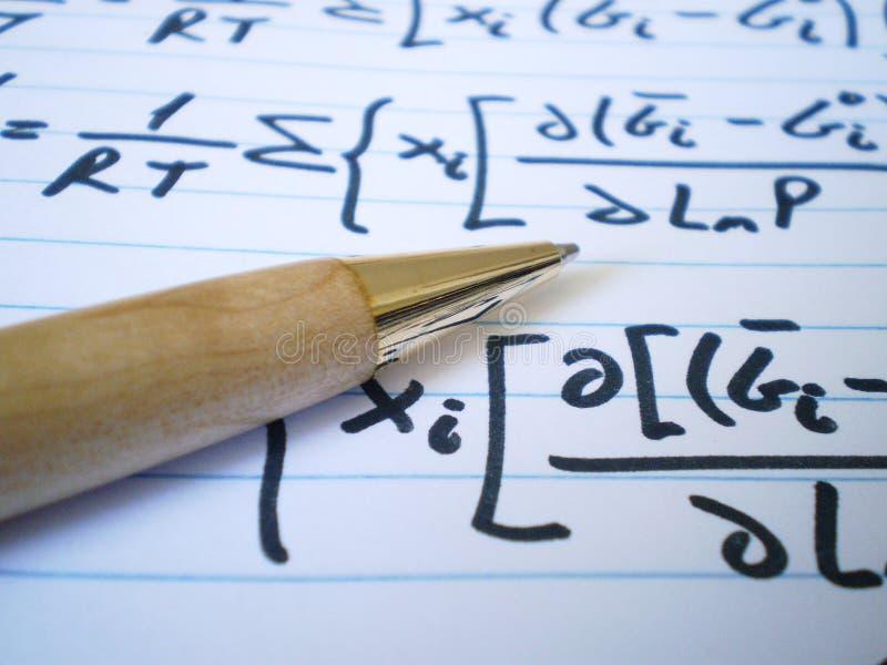 Crayon lecteur et équations photographie stock libre de droits