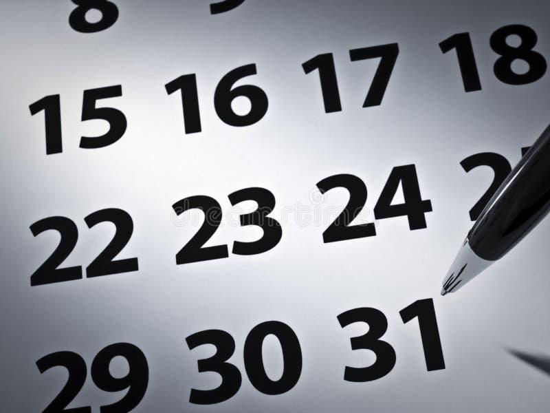 Crayon lecteur et calendrier photographie stock