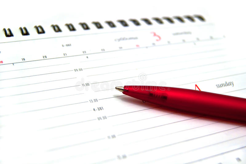 Crayon lecteur sur l'agenda ouvert images libres de droits