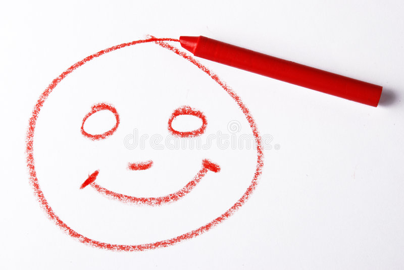 Crayon smile. A crayon draw a smiley on white background stock photo