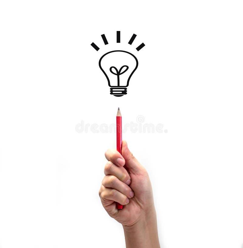Crayon tenu dans la main avec la ligne icône de lampe d'isolement sur le fond blanc, créativité photographie stock libre de droits