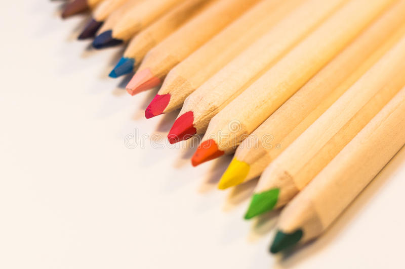 Crayons lined up stock images