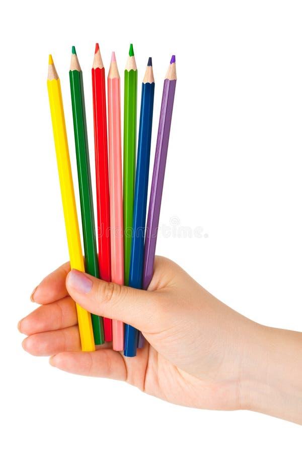 crayons multicolores de main image libre de droits